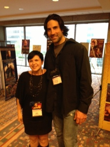 R.K. Ryals and cover model, Harley, at the 2013 RT convention.